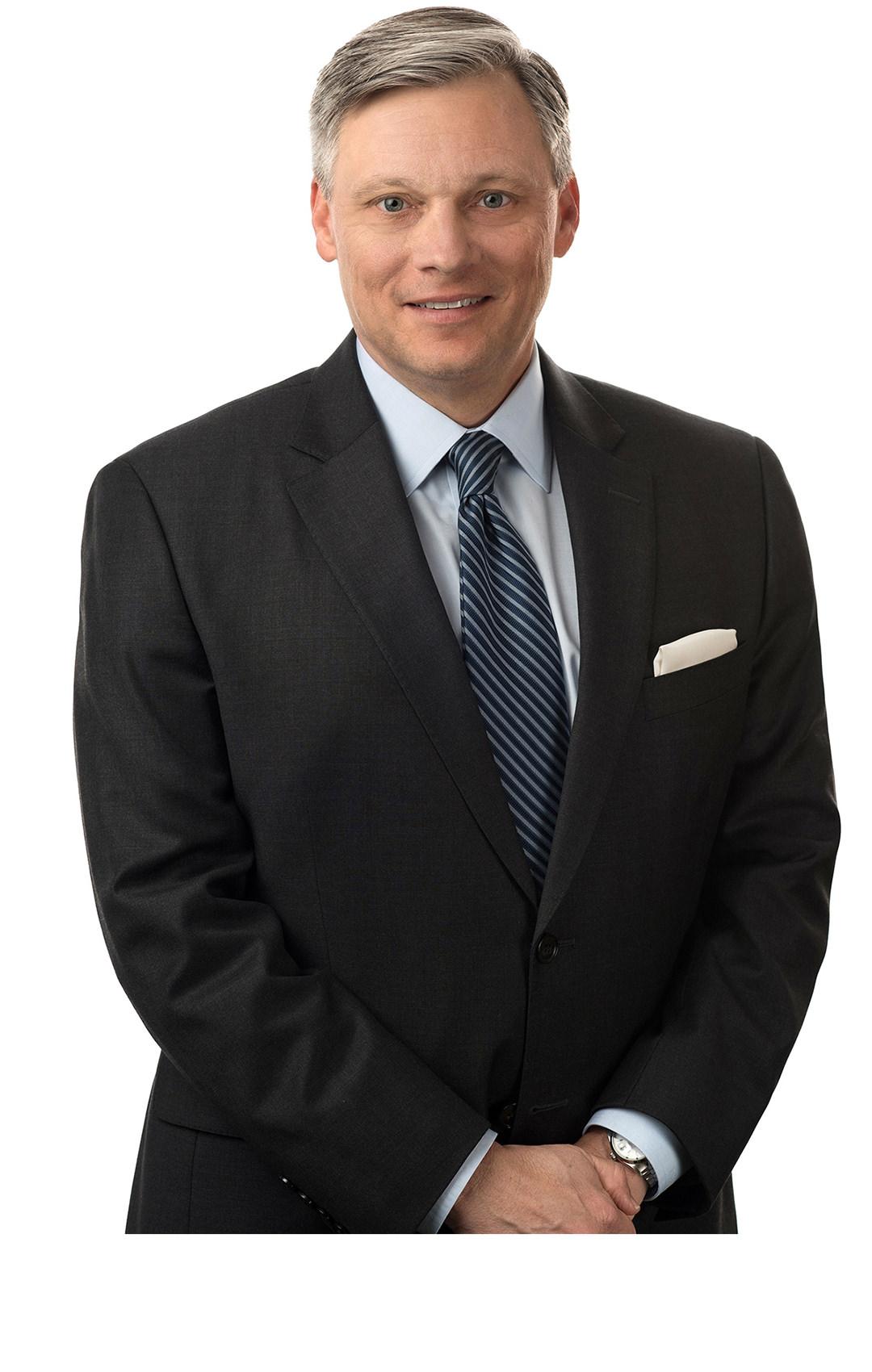 Timothy E. Madden