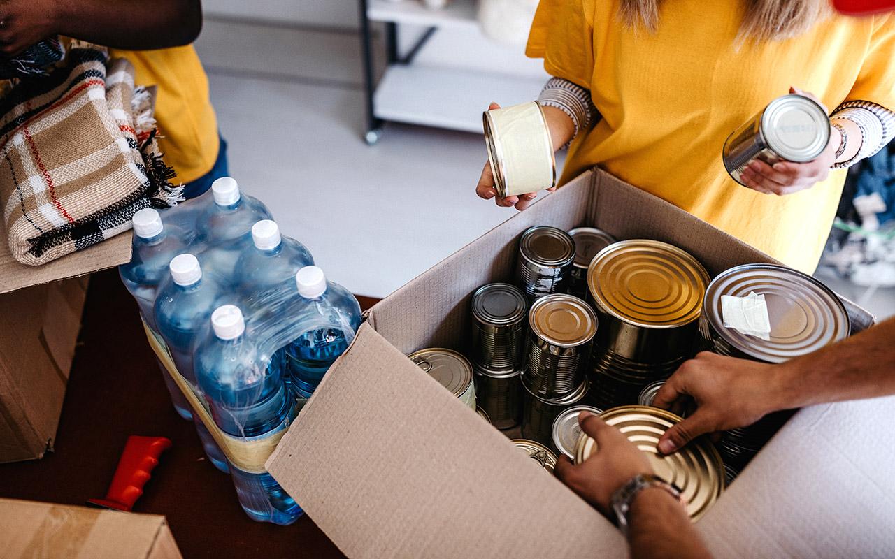 Encompass Team Members Pack Food for Harvest Hope Food Bank